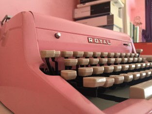 Pink Typewriter with White Keys Angle View